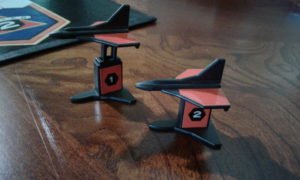 Game pieces with different altitudes
