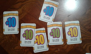 The game ends when six +10 cards have been played.