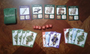 Dragonwood deck in play, adventurer card combinations, and dice.
