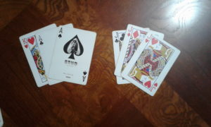 Right player led with three jacks. Left player won the trick with two aces and a king.
