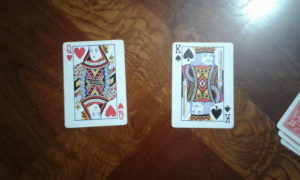 Left player then leads the second trick with a queen. Right player wins trick with a king.